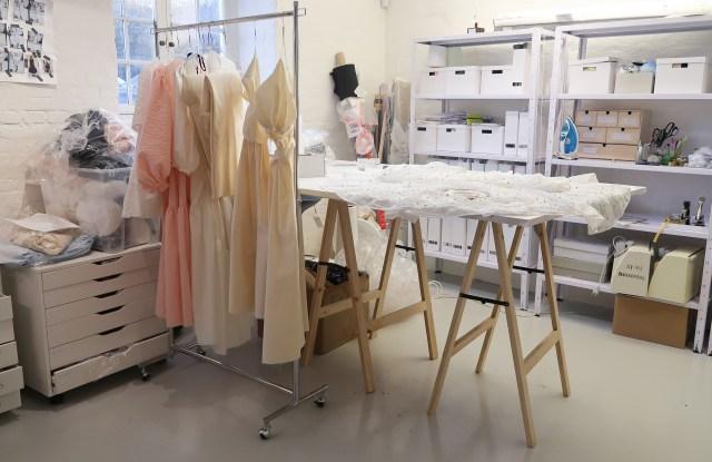 Dresses hang in Cecile Bahnsen's studio.