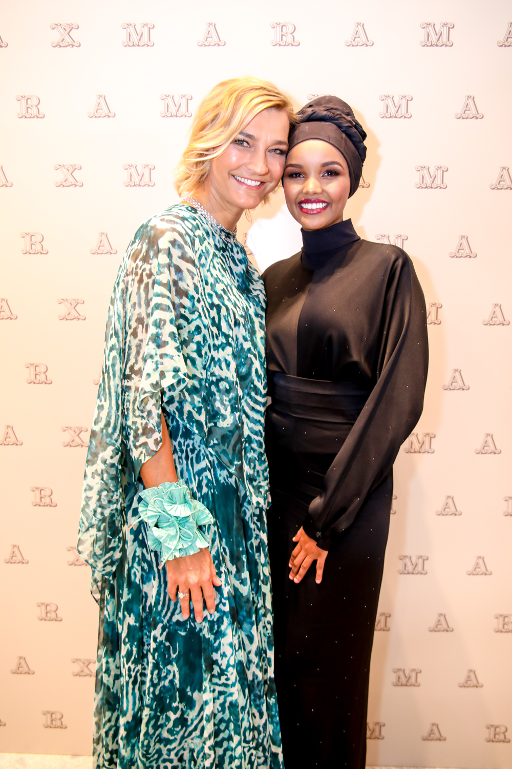 Nicola Maramotti and Halima Aden at the new Max Mara flagship in Dubai