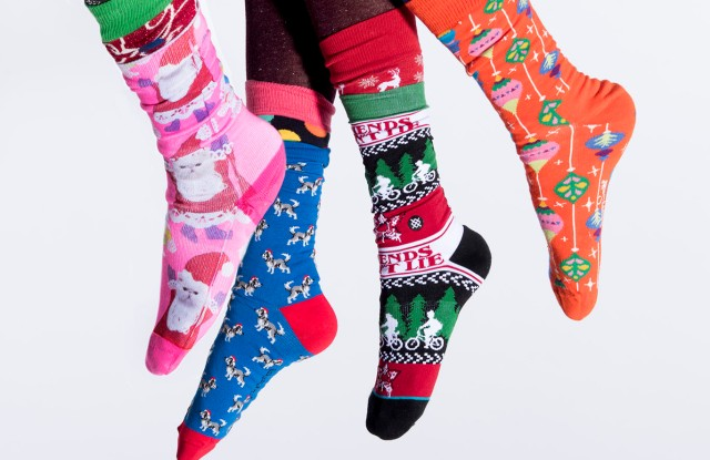 From left: Happy Socks' sock under Stance's santa cat sock; Happy Socks' socks; Express' sock under Stance's sock; Happy Socks' socks, and Calzedonia tights (worn under throughout).