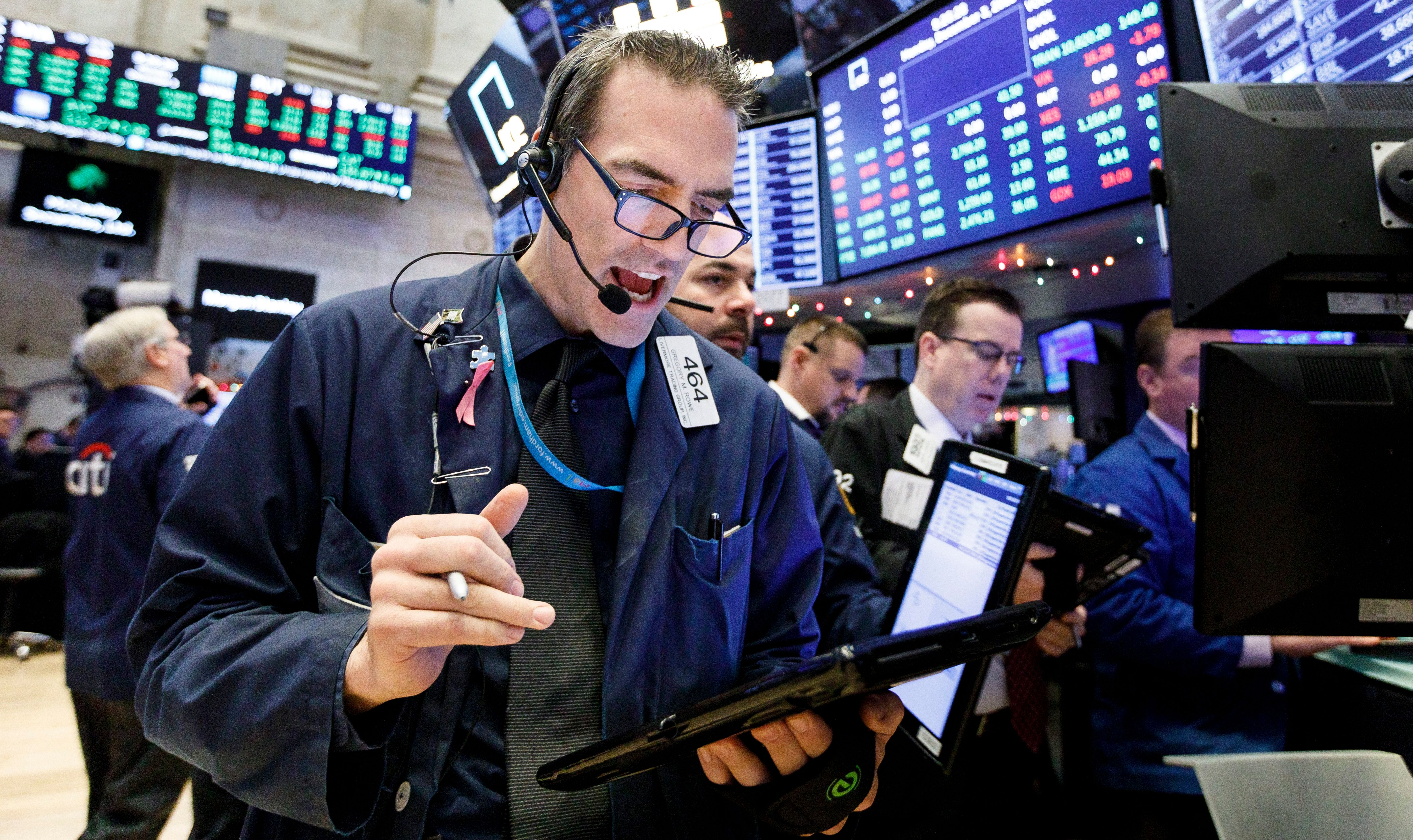 Traders work on the floor of the New York Stock Exchange in New York, New York, USA, 03 December 2018. Global markets were sharply higher today following reports that the United States and China have made progress in their trade dispute.New York Stock Exchange, USA - 03 Dec 2018
