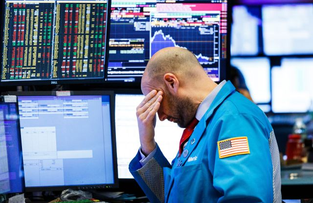 A trader works on the floor of the New York Stock Exchange at the closing bell in New York, New York, USA, on 04 December 2018. The Dow Jones industrial average lost almost 800 points today, or 3.1%, as investors continued to react to the details of the reported trade deal between the United States and China.New York Stock Exchange, USA - 04 Dec 2018