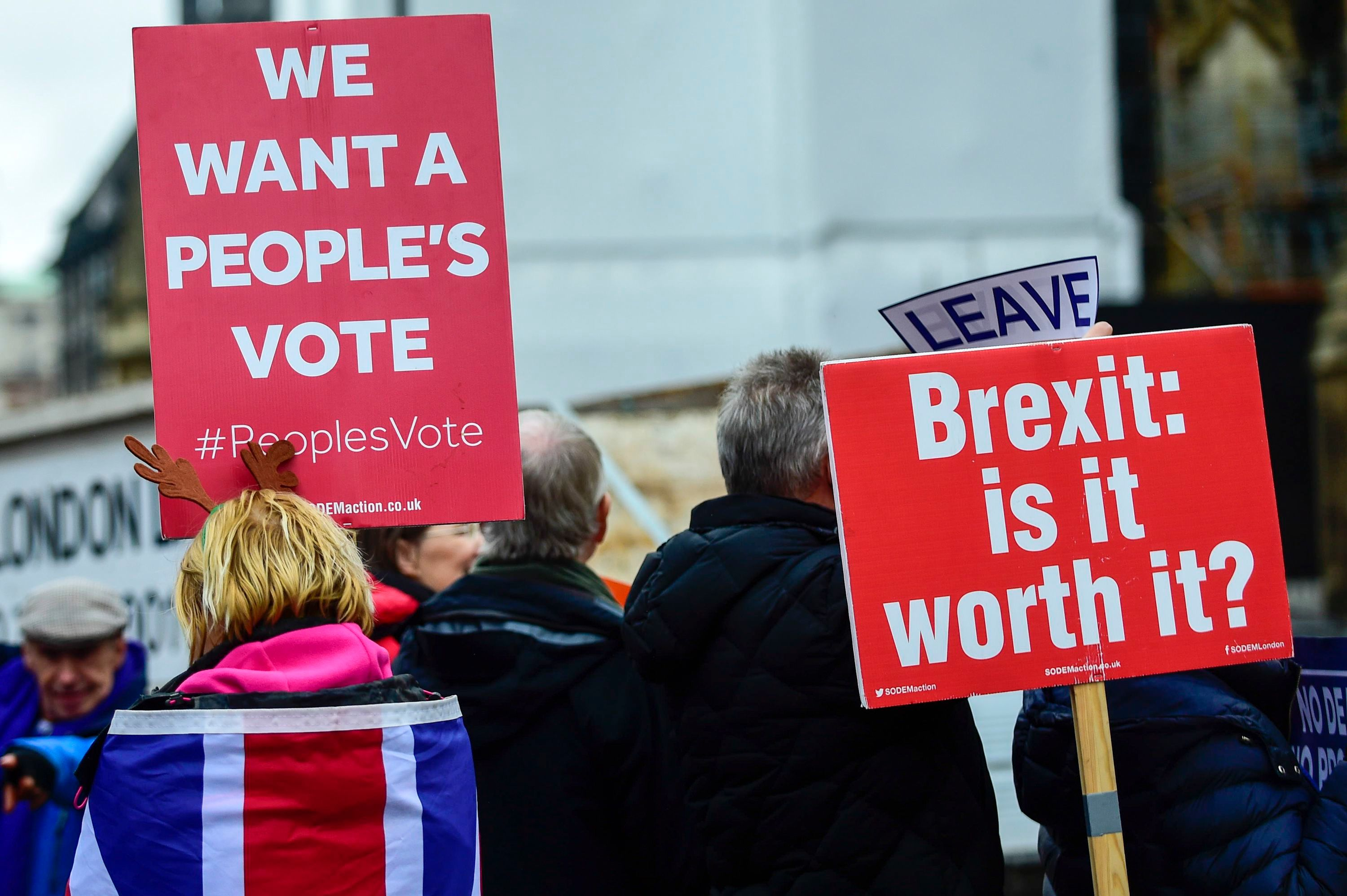 Anti-Brexit supporters demonstrate outside the Houses of Parliament as MPs debated Theresa May's Brexit deal.