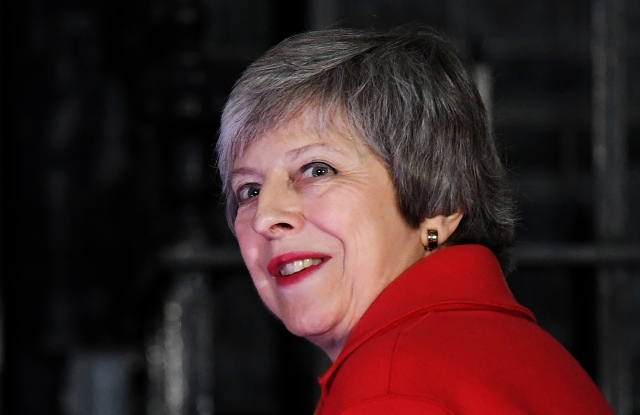 British Prime Minister Theresa May after switching on the Christmas tree lights outside 10 Downing Street in London, Britain, 06 December 2018. May is holding five days of debate over Brexit at parliament, hoping to persuade MPs to vote for her EU Brexit deal.Christmas tree lights at 10 Downing Street in London, United Kingdom - 06 Dec 2018