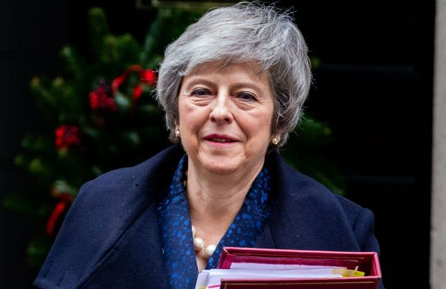 Prime Minister, Theresa May, leaves 10 Downing Street for Prime Minister's Questions. There have been at least 48 letters handed in to Graham Brady, Chair of the 1922 Committee and tonight she faces a vote of no confidence from her party in the House of Commons.Prime Minister's Questions, London, UK-12 Dec 2018
