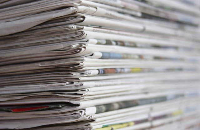 Stacked newspapersVARIOUS