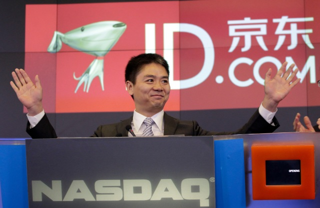 Qiangdong Liu, CEO of JD.com, raises his armsprior to the opening of the Nasdaq market, in New York. JD.com, China's No. 2 e-commerce service, is headquartered in BeijingWall Street IPO JD.com, New York, USA
