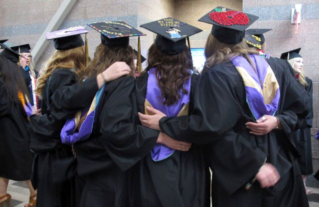 Carroll College students pose for a photo before their graduation ceremony in Helena, Mont. With a week to go before the May 25 special congressional election, Democrat Rob Quist is hoping his outreach to college students will pay off at the ballot box. The college vote is an important part of Quist's get-out-the-vote strategy against Republican Greg Gianforte and Libertarian Mark Wicks to fill the seat vacated by Ryan Zinke when he became President Donald Trump's Interior secretaryMontana Special Election College Voters, Helena, USA - 13 May 2017