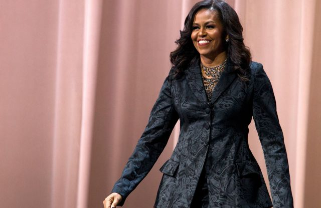 "Former first lady Michelle Obama walks on stage during a stop on her book tour for ""Becoming,"" in WashingtonMichelle Obama Book Tour, Washington, USA - 25 Nov 2018"