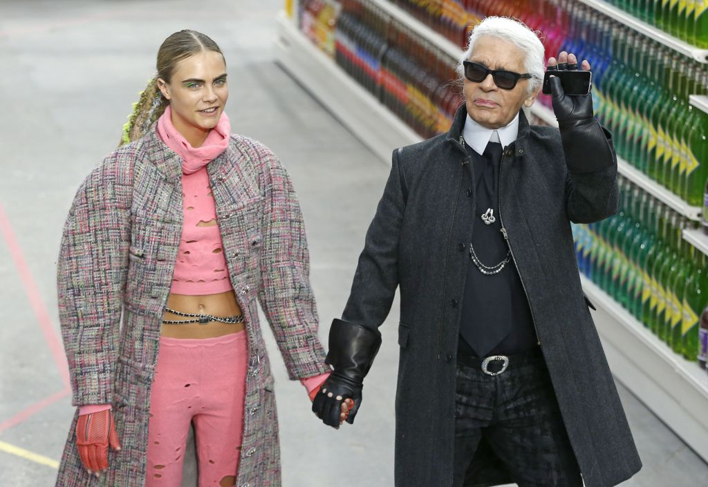 German Designer Karl Lagerfeld (r) and British Model Cara Delevingne (l) Take to the Catwalk at the End of the Fall/winter 2014/15 Ready to Wear Collection by Chanel in Paris France 04 March 2014 the Presentation of the Women's Collections Runs From 25 February to 05 March France ParisFrance Paris Fashion Week - Mar 2014