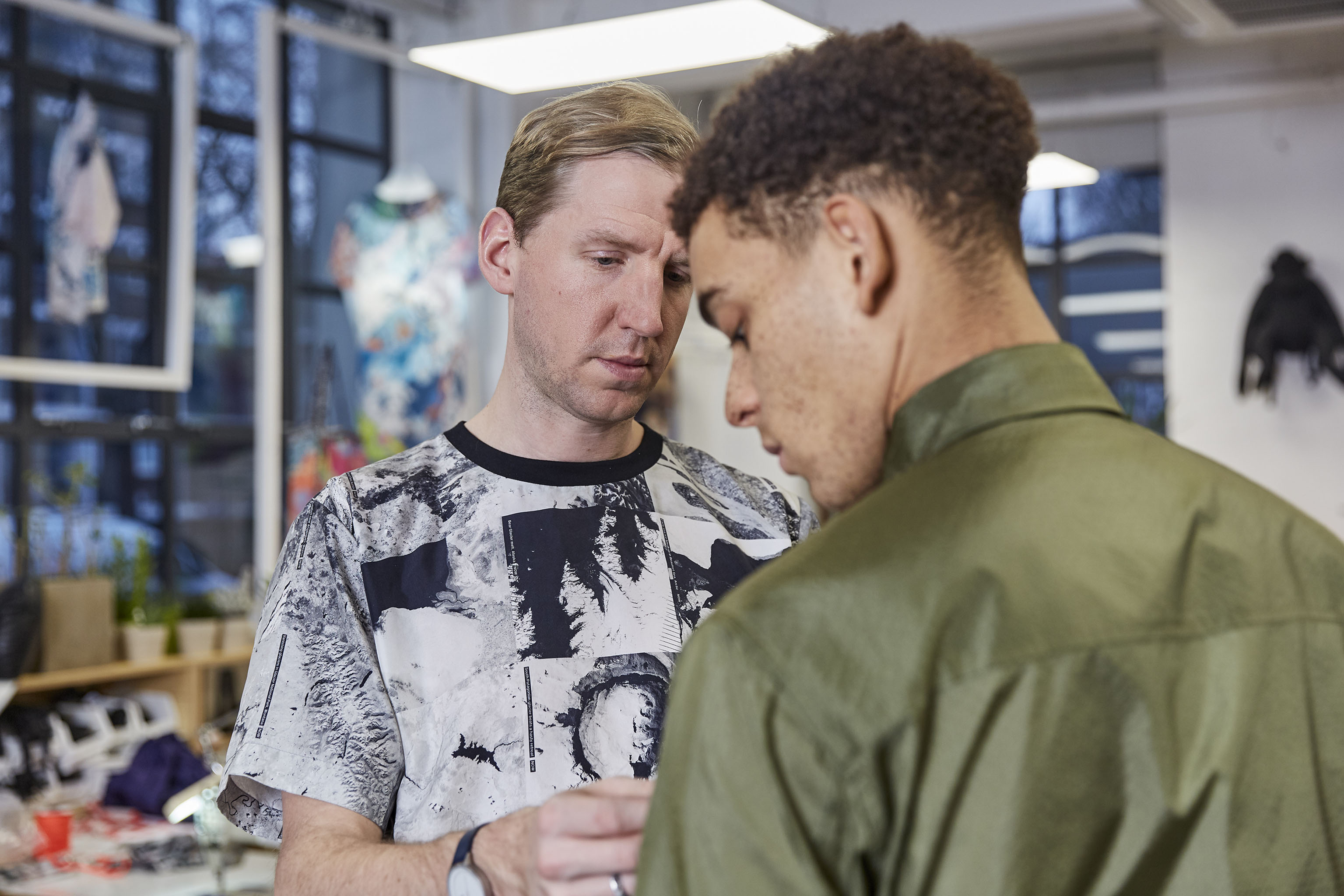 Christopher Raeburn fitting a model in one of his looks.
