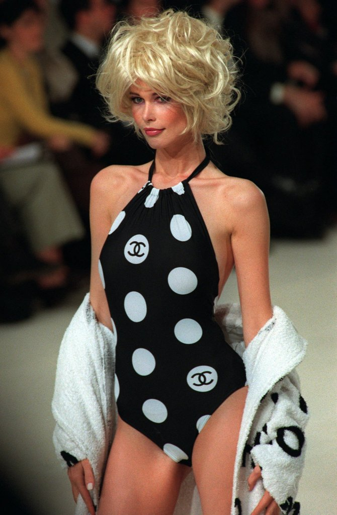 CLAUDIA SCHIFFER German top model Claudia Schiffer sports a dotted black swimsuit with a white bathrobe designed by Karl Lagerfeld for Chanel's 1997 Spring-Summer ready-to-wear collection presented in ParisFRANKREICH MODE SCHIFFER, PARIS, France