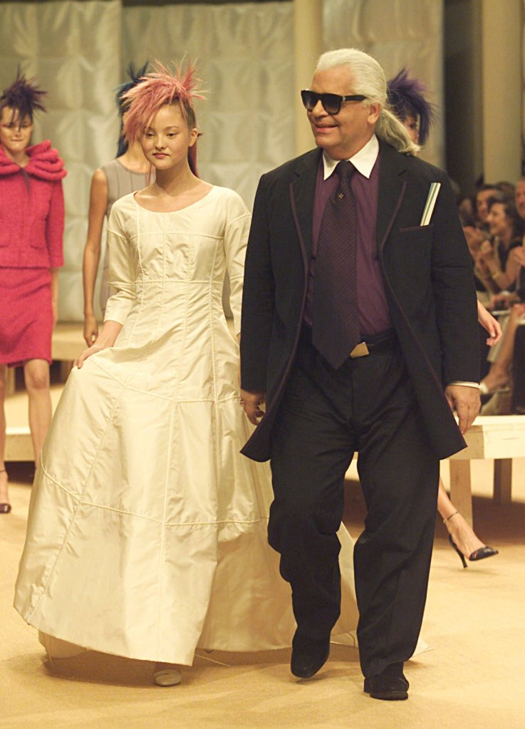LAGERFELD AOKI German fashion designer Karl Lagerfeld, right, walks with Japanese top model Devon Aoki wearing the wedding gown after the presentation of the fall-winter 1999/2000 Haute Couture collection from Chanel Tuesday July 20,1999 in ParisFRANCE FASHION, PARIS, France