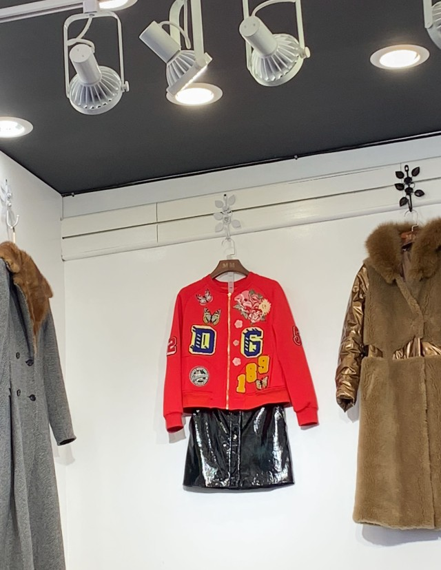 A cardigan with Dolce & Gabbana's initials at a store in Flushing.