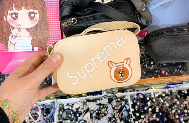 """At Fashion City, """"Supreme"""" merchandise is something like fashion fan fiction, here featuring the brand's name alongside a character from Line App Friends."""