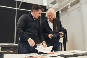 Kevin Plank and Richard Branson work on the space astronaut collection.