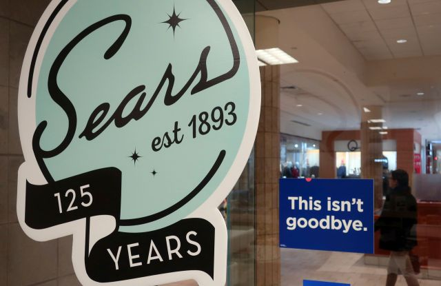 """In this Nov. 2, 2018 photo, a sign in the window at Sears promises that """"This isn't goodbye,"""" at the Livingston Mall in Livingston, N.J. Sears is closing 80 more stores as it teeters on the brink of liquidation. The 130-year old retailer set a deadline of for bids for its remaining stores to avert closing down completelySears, Livingston, USA - 02 Nov 2018"""