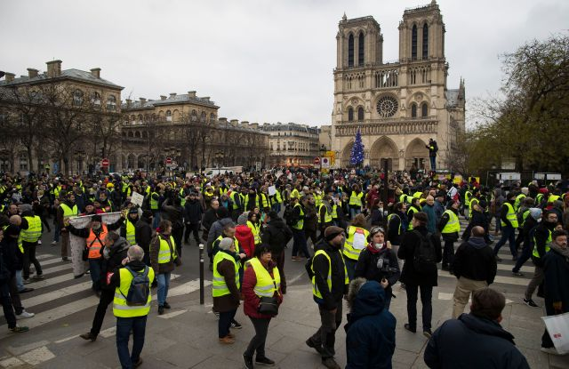 Protesters walk alongside the Seine river during a 'Yellow Vests' protest in Paris, France, 05 January 2019. The so-called 'gilets jaunes' (yellow vests) is a grassroots protest movement with supporters from a wide span of the political spectrum, that originally started with protest across the nation in late 2018 against high fuel prices. The movement in the meantime also protests the French government's tax reforms, the increasing costs of living and some even call for the resignation of French President Emmanuel Macron.Yellow vests protest in Paris, France - 05 Jan 2019