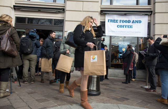 Federal employees and family members (C) that have been affected by the ongoing shutdown of the US federal goverment leave with free meals provided to them by World Central Kitchen, at Jose Andres' ThinkFoodLab in Washington, DC, USA, 16 January 2019. The disaster relief nonprofit World Central Kitchen, led by celebrity chef Jose Andres, opened a Washington DC feeding site 16 January to try to help some of the 800,000 federal workers that are either working without pay or have been furloughed. Free hot meals and to-go meals will be provided everyday, including weekends. The shutdown began 22 December 2018 and is now the longest in US history with no clear end in sight.Chef Jose Andres opens a World Central Kitchen feeding site to provide food to US federal government employees in need, Washington, USA - 16 Jan 2019