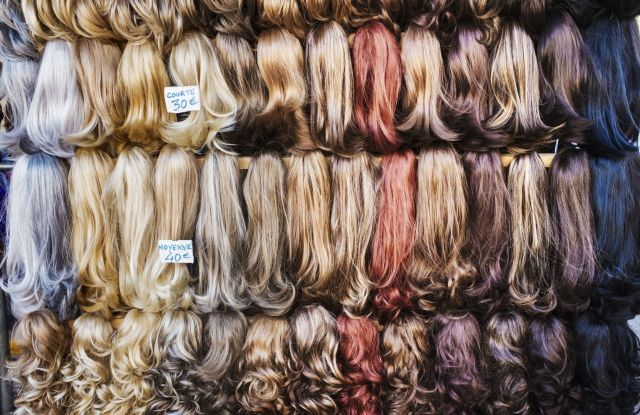 A display of hair extensions and hair pieces of different colours.VARIOUS