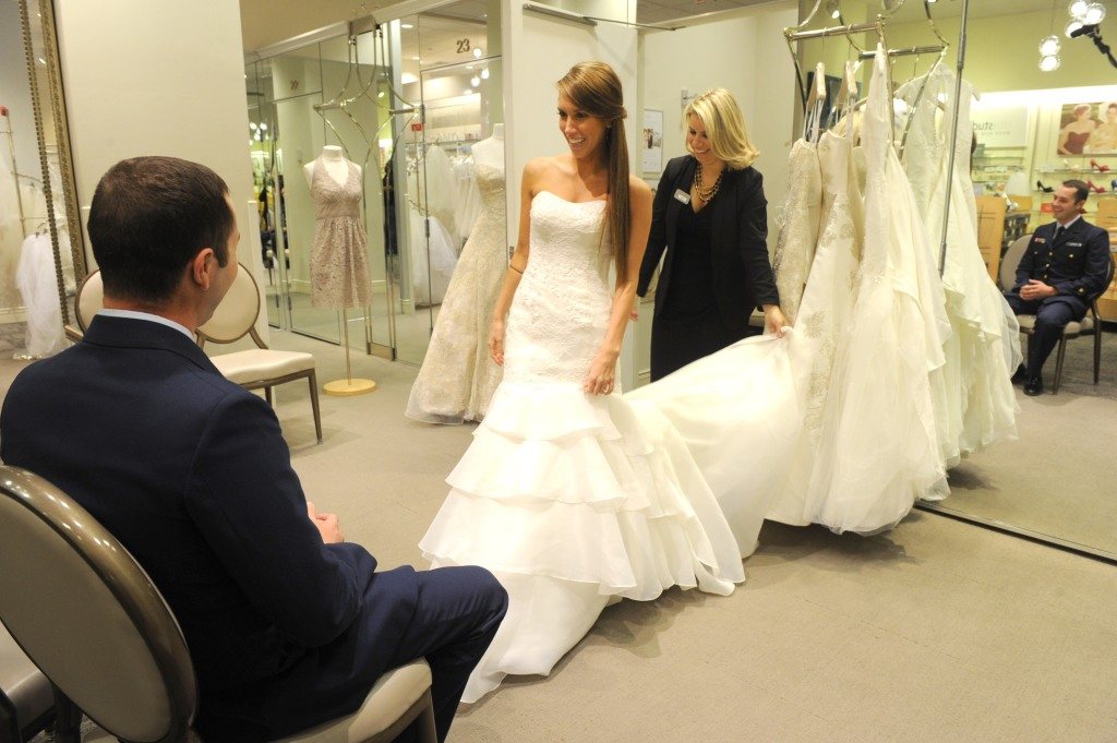 IMAGE DISTRIBUTED FOR DAVIDS BRIDAL - USO Coast Guardsman of the Year, Sam Peikert, stationed in Opa Locka, Fla., and his bride-to-be, Jackie Fairchild, of Houston, Texas, shop for wedding gowns at the David's Bridal store on Veterans Day, in New York, after his surprise proposal on television with recording artist Jason Derulo. David's Bridal is showing its support for Veterans Day by offering a 20 percent discount to all service members and veterans through Nov. 15Veterans Day, New York, USA