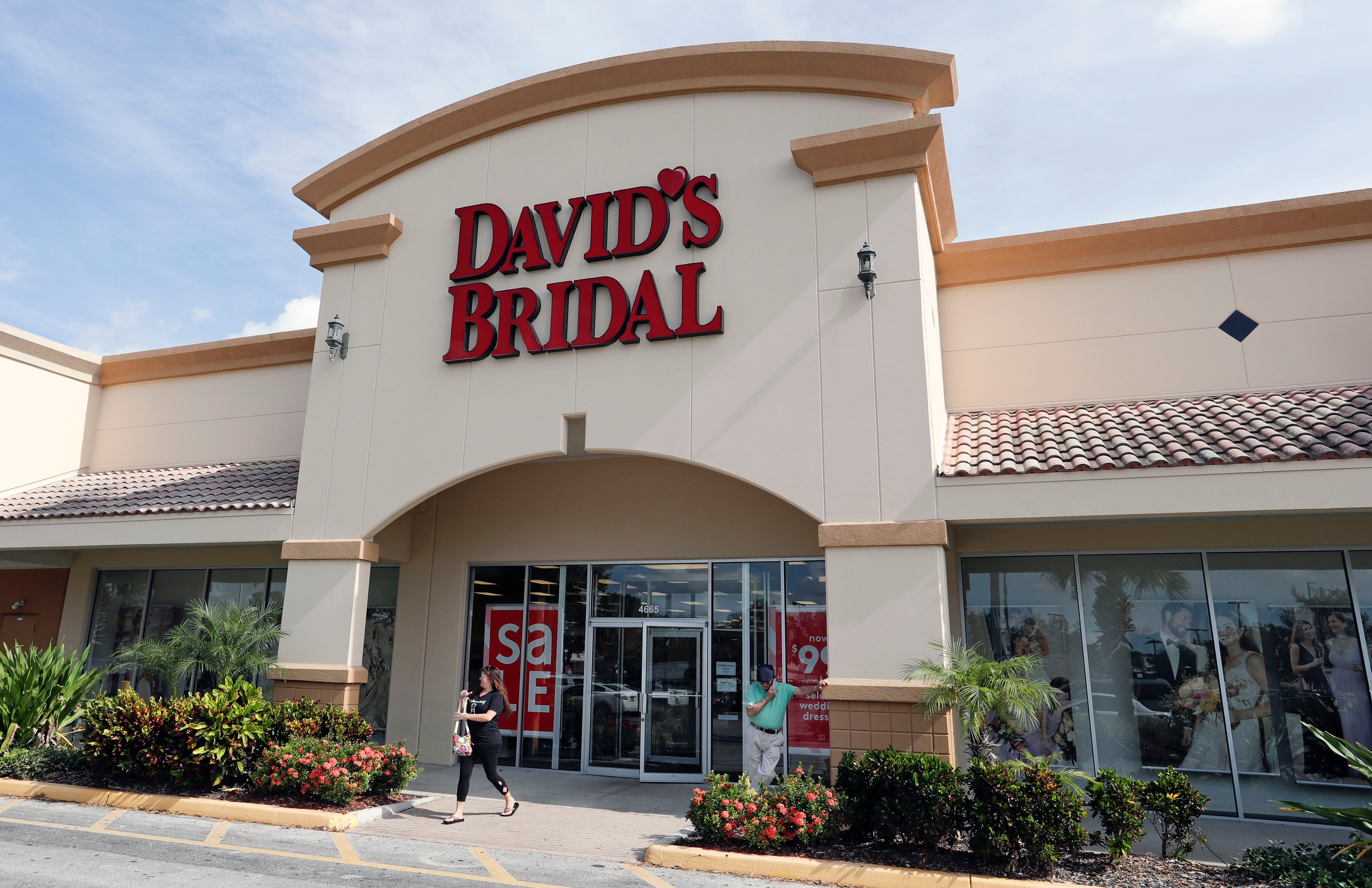 The entrance to a David's Bridal store is seen, in Orlando, Fla. David's Bridal is filing for bankruptcy protection but there is no danger for customers who have ordered dresses because operations are continuing as normal while the wedding and prom retailer restructuresDavids Bridal Bankruptcy, Orlando, USA - 19 Nov 2018