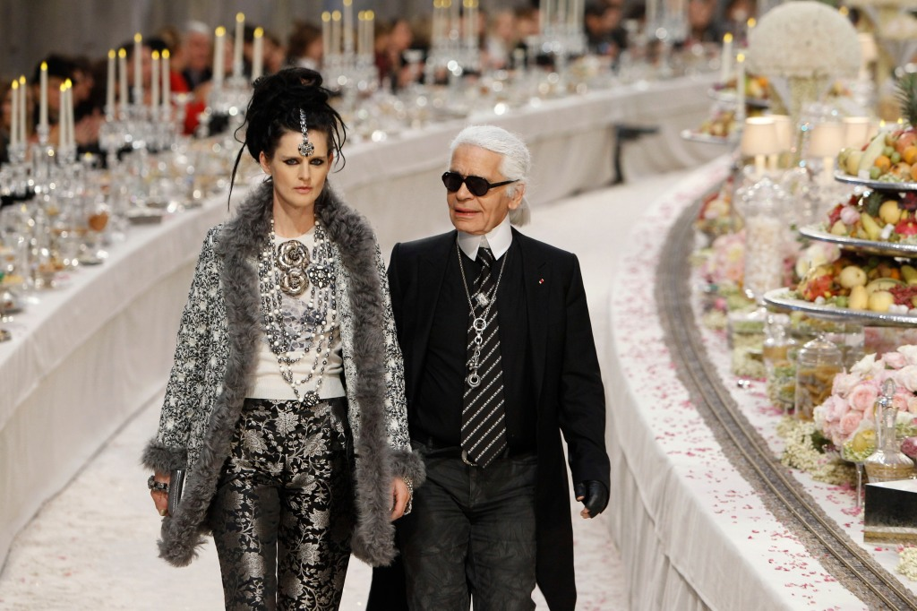 Karl Lagerfeld, Stella Tennant German fashion designer Karl Lagerfeld with at his side British model Stella Tennant, left, acknowledges applause at the end of the presentation of his Paris-Bombay collection for Chanel, presented at the Grand Palais in ParisFrance Fashion Chanel, Paris, France