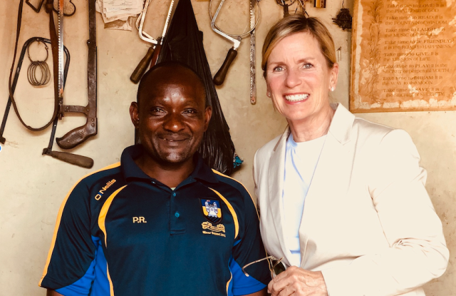 Joanne Calabrese with one of Soko's artisans, Samuel Sumba Achayo, in his workshop.