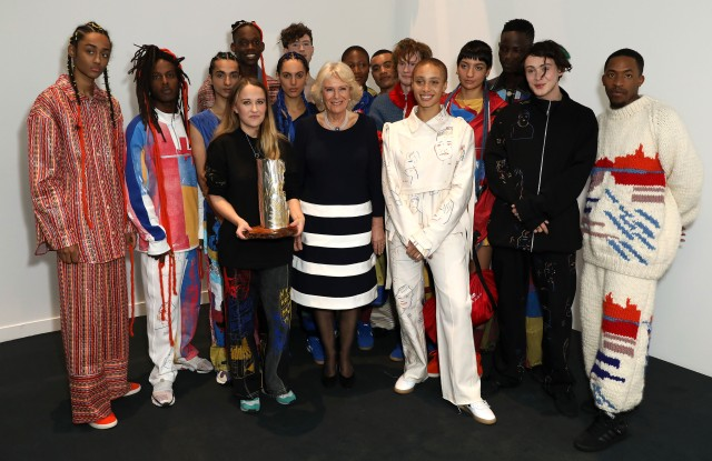 Bethany Williams, Her Royal Highness The Duchess of Cornwall and Adwoa Aboah with models wearing Williams's fall 2019 collection