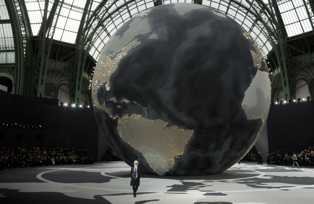 Fashion designer Karl Lagerfeld on the runway after Chanel's fall 2013 show at the Grand Palais.