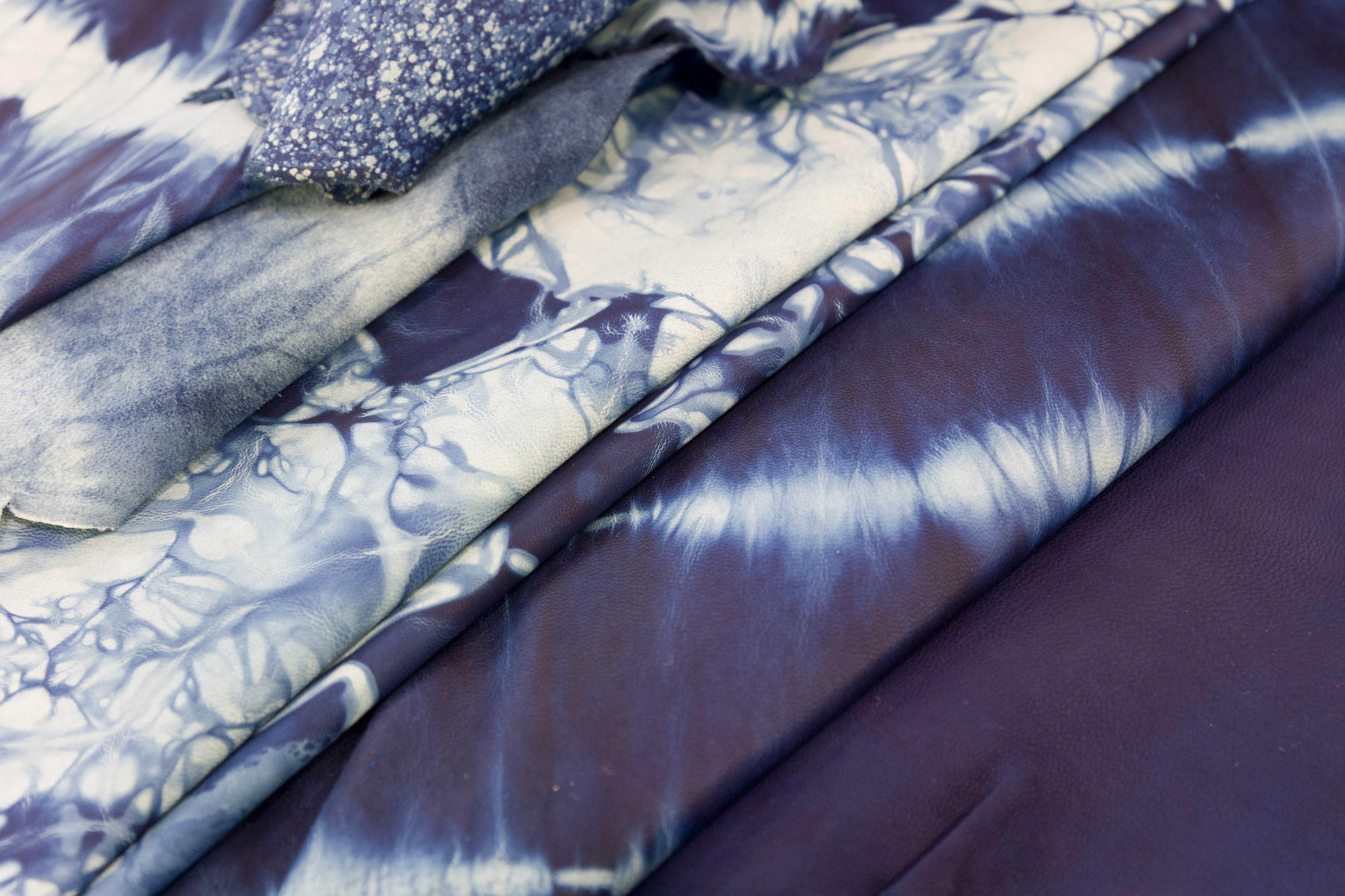 Indigo-dyed leathers using kimono techniques by Sukumo Leather.