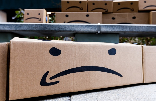 Boxes with a reimagined Amazon logo during a protest related to the recent announcement that the company Amazon will be opening one of two new headquarters in New York, New York, USA, 30 November 2018. The protest was held by students from the City University of New York who are upset with school's board for supporting the Amazon deal in the Long Island City neighborhood and how it may affect public funding of education.Rally Against Amazon Headquarters Deal in New York, USA - 30 Nov 2018