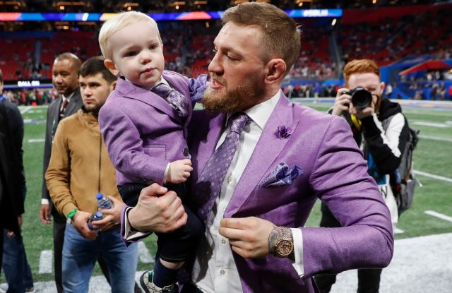 UFC fighter Conor McGregor and his son Conor McGregor jr. on the field prior to Super Bowl LIII between the New England Patriots and the Los Angeles Rams at Mercedes-Benz Stadium in Atlanta, Georgia, USA, 03 February 2019.Super Bowl LIII, Atlanta, USA - 03 Feb 2019