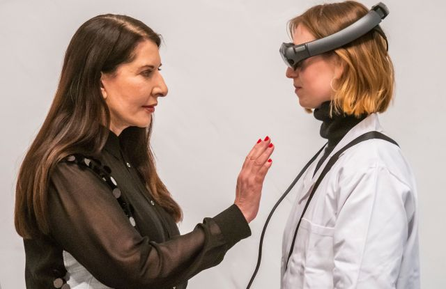 Marina Marina Abramovic with a technicianMarina Abramovic: The Life exhibition, London, UK - 18 Feb 2019Marina Abramovic: The Life at the Serpentine Gallery, a perfomance in Mixed Reality (a wearable augmented experience). The piece, lasting 19 minutes, builds on the artist?s long-standing fascination with the notion of material absence. The use of Mixed Reality allows AbramoviÄ? to explore how to use her own body as subject and object, mapping new territory at the intersection of technology and performance. The Life is produced by Tin Drum, a US/UK studio that works exclusively in Mixed Reality. It runs from 19 - 24 February 2019