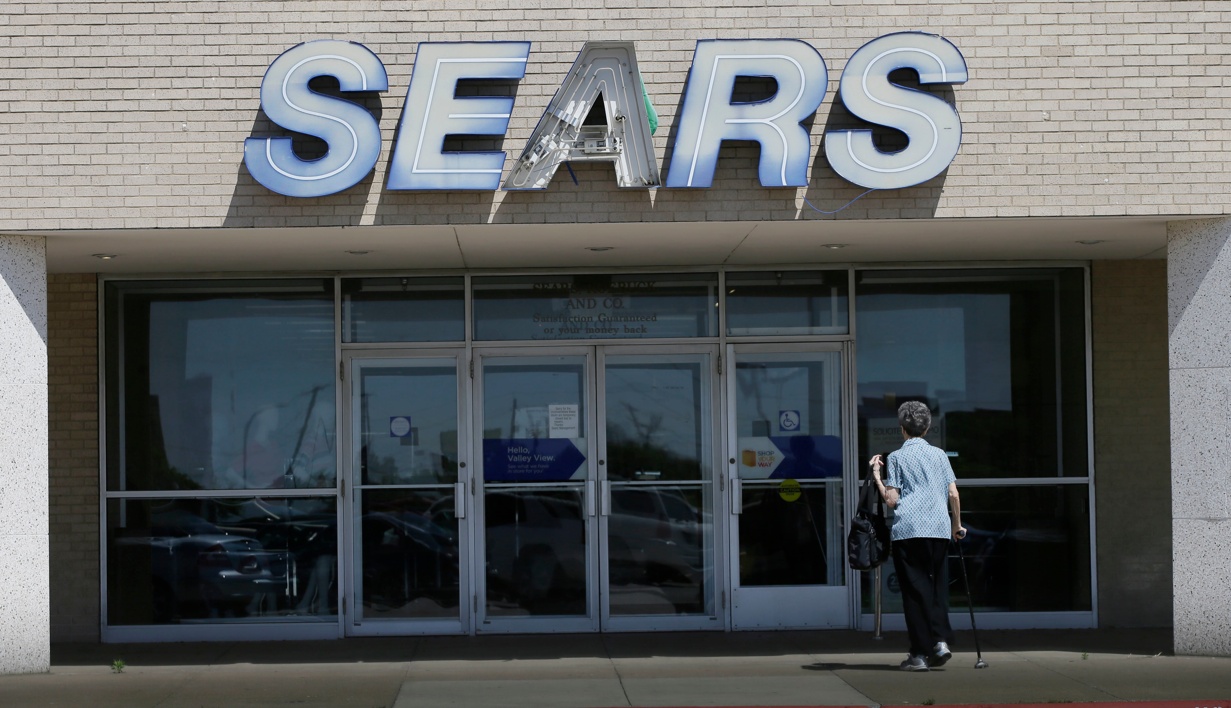 An elderly woman walks outside a Sears retail store scheduled to be shut down in north DallasSears, Dallas, USA - 23 Mar 2017