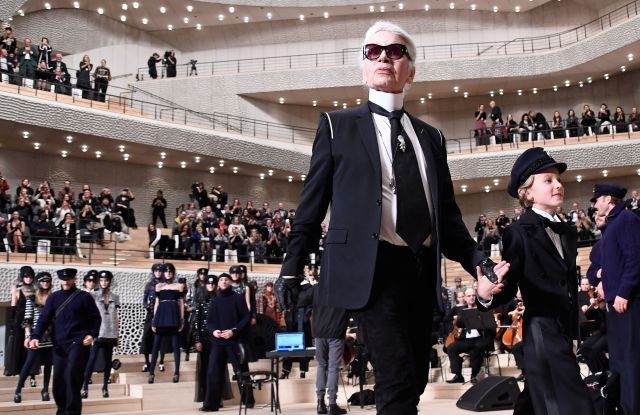 Karl Lagerfeld and Hudson Kroenig on the catwalk at the Chanel Metiers d'Art show in Hamburg