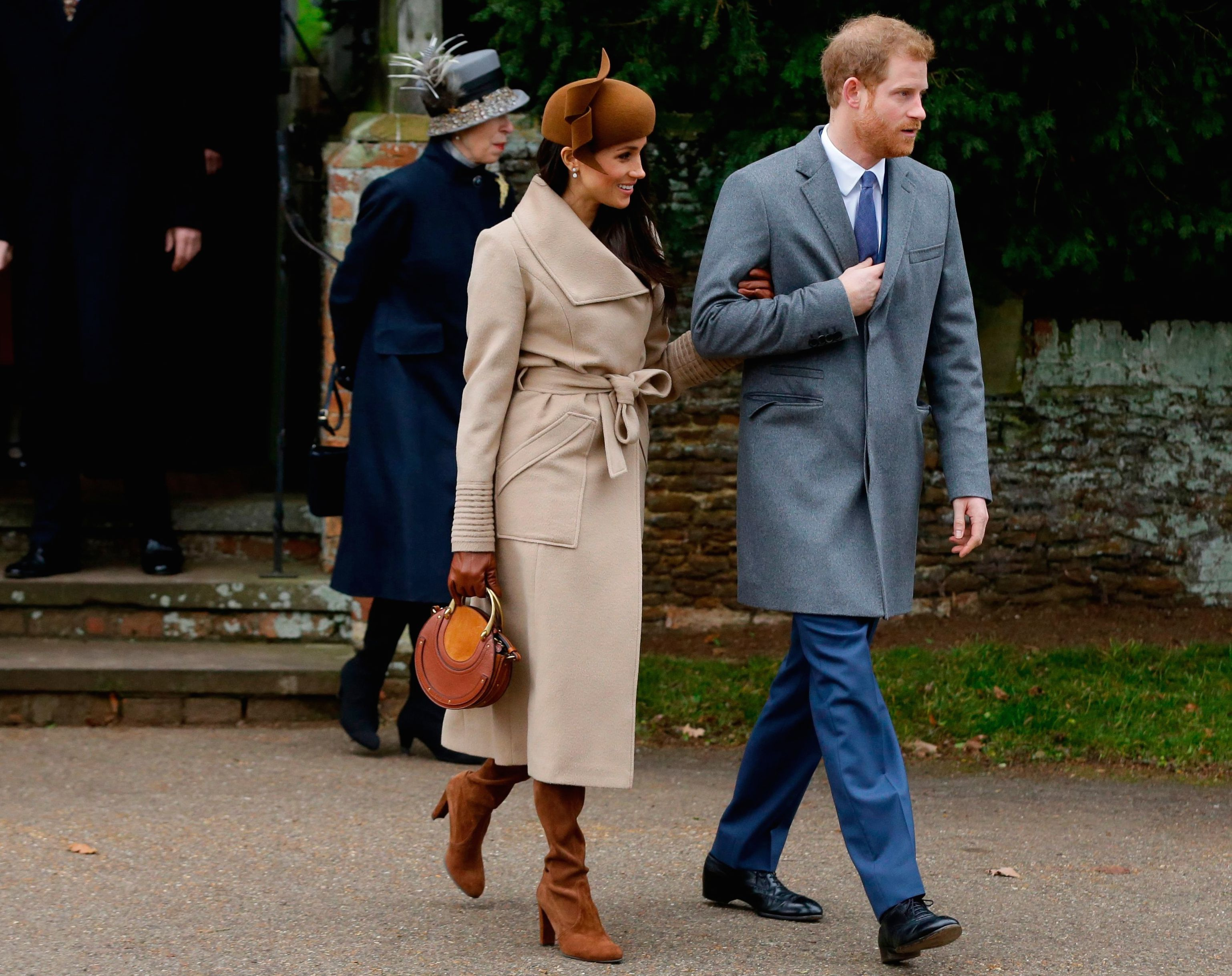 """Britain's Prince Harry and his fiancee Meghan Markle leave the traditional Christmas Day church service, at St. Mary Magdalene Church in Sandringham, England. As Prince Harry's future bride left a church service on the grounds of Queen Elizabeth II's private country estate, designer Bojana Sentaler recognized her coat """"I was looking for the ribbed sleeves, hoping it was a Sentaler coat,'' said the designer, who met Markle when she was a mere TV star. The Meghan magic was almost instantaneous; Markle's coat sold out, as Sentaler expected, and the publicity fueled sales of other designsBritain Markle's Magic, Sandringham, United Kingdom - 25 Dec 2017"""