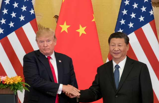 "Donald Trump, Xi Jinping. President Donald Trump and Chinese President Xi Jinping shake hands during a joint statement to members of the media Great Hall of the People in Beijing, China. The U.S. is announcing that it will impose a 25 percent tariff on $50 billion worth of Chinese goods containing ""industrially significant technology."" The White House said, that the tariff will cover goods related to the ""Made in China 2025"" program. The full list of imports that will be covered will be announced by June 15Trade, Beijing, China - 09 Nov 2017"