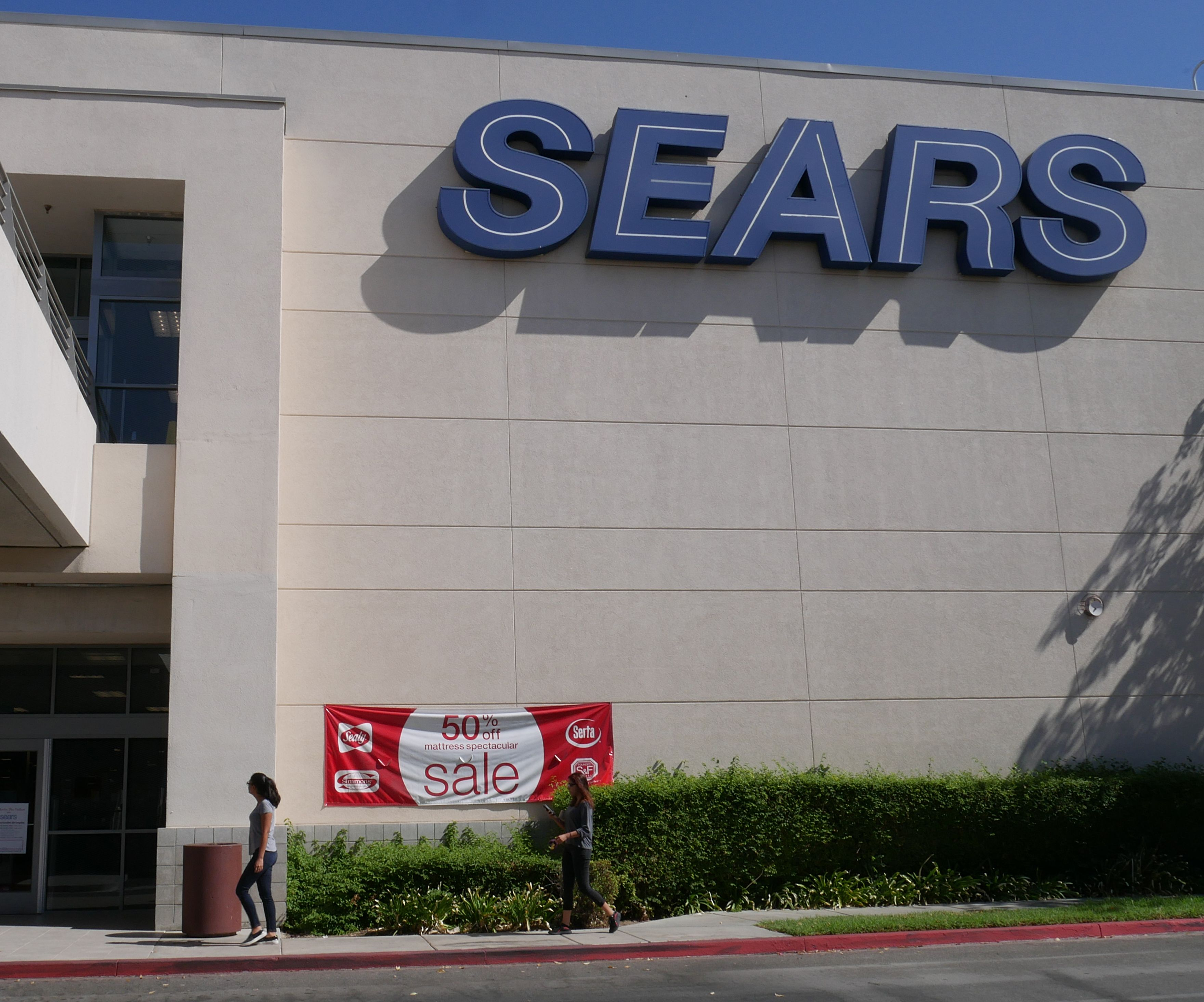 Customers enter a Sears store in Northridge, California, USA, 11 October 2018. The iconic company, which was founded in 1892, is preparing to file for bankruptcy. The bankruptcy could be filed as soon as 14 October 2018 and would cause one of the biggest pension defaults in US history.Sears prepares to file for bankruptcy in the USA, Northridge - 11 Oct 2018