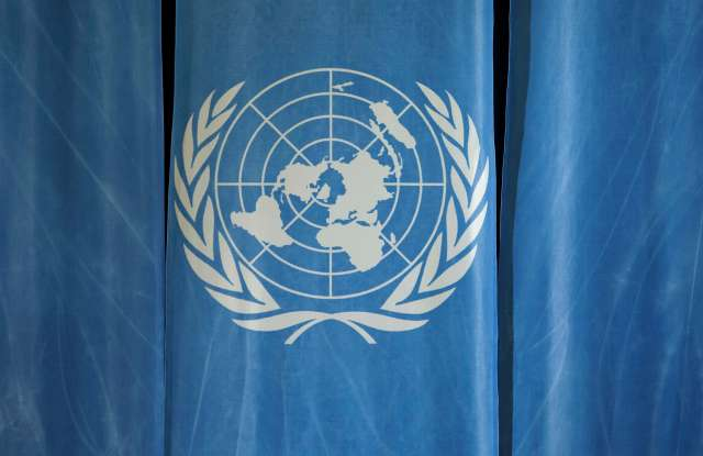 The UN logo at a press conference of United Nations Conference on Trade and Development (UNCTAD) in Geneva