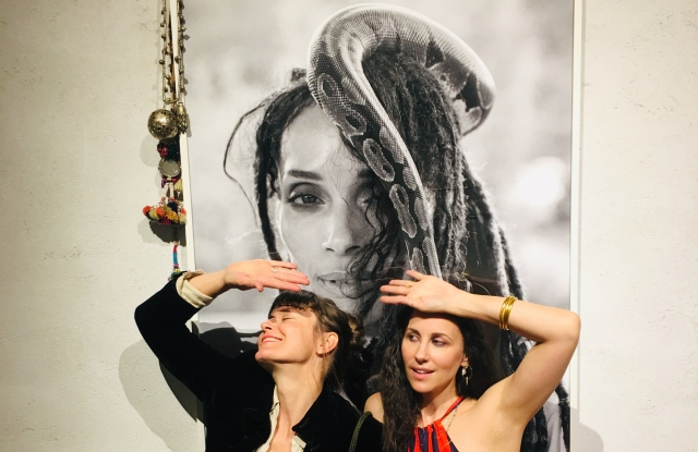 Photographer Magdalena Wosinka, left, and Raquel Allegra in front of an image of Lisa Bonet.