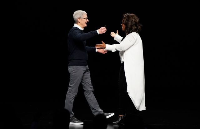 Apple CEO Tim Cook and Oprah Winfrey prepare to embrace at the Steve Jobs Theater during an event to announce new products, in Cupertino, CalifApple Streaming TV, Cupertino, USA - 25 Mar 2019
