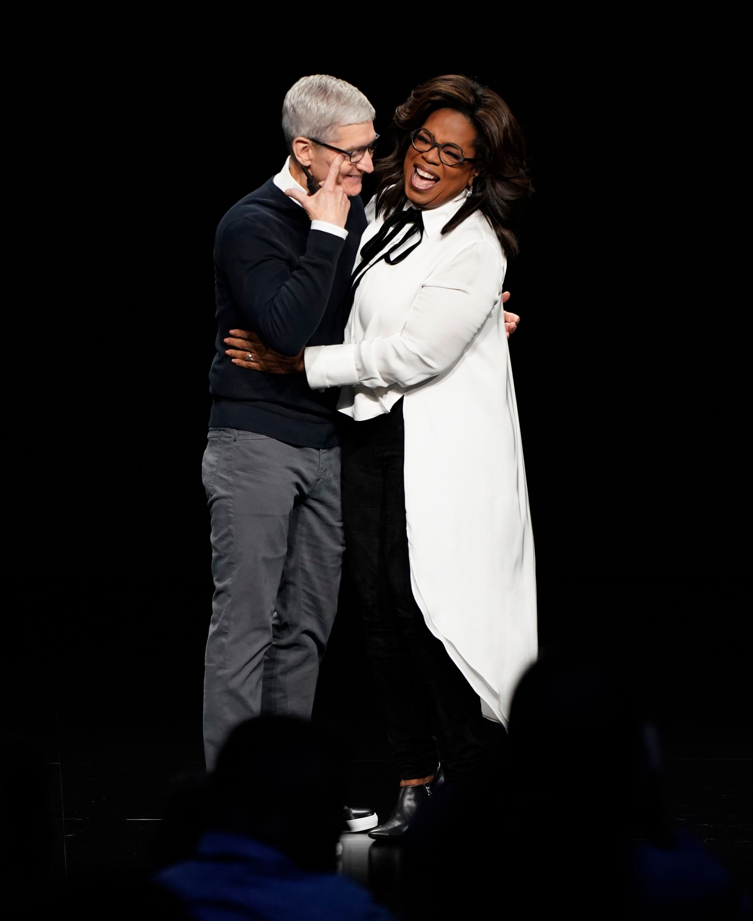 Apple CEO Tim Cook and Oprah Winfrey embrace at the Steve Jobs Theater during an event to announce new Apple products, in Cupertino, CalifApple Streaming TV, Cupertino, USA - 25 Mar 2019