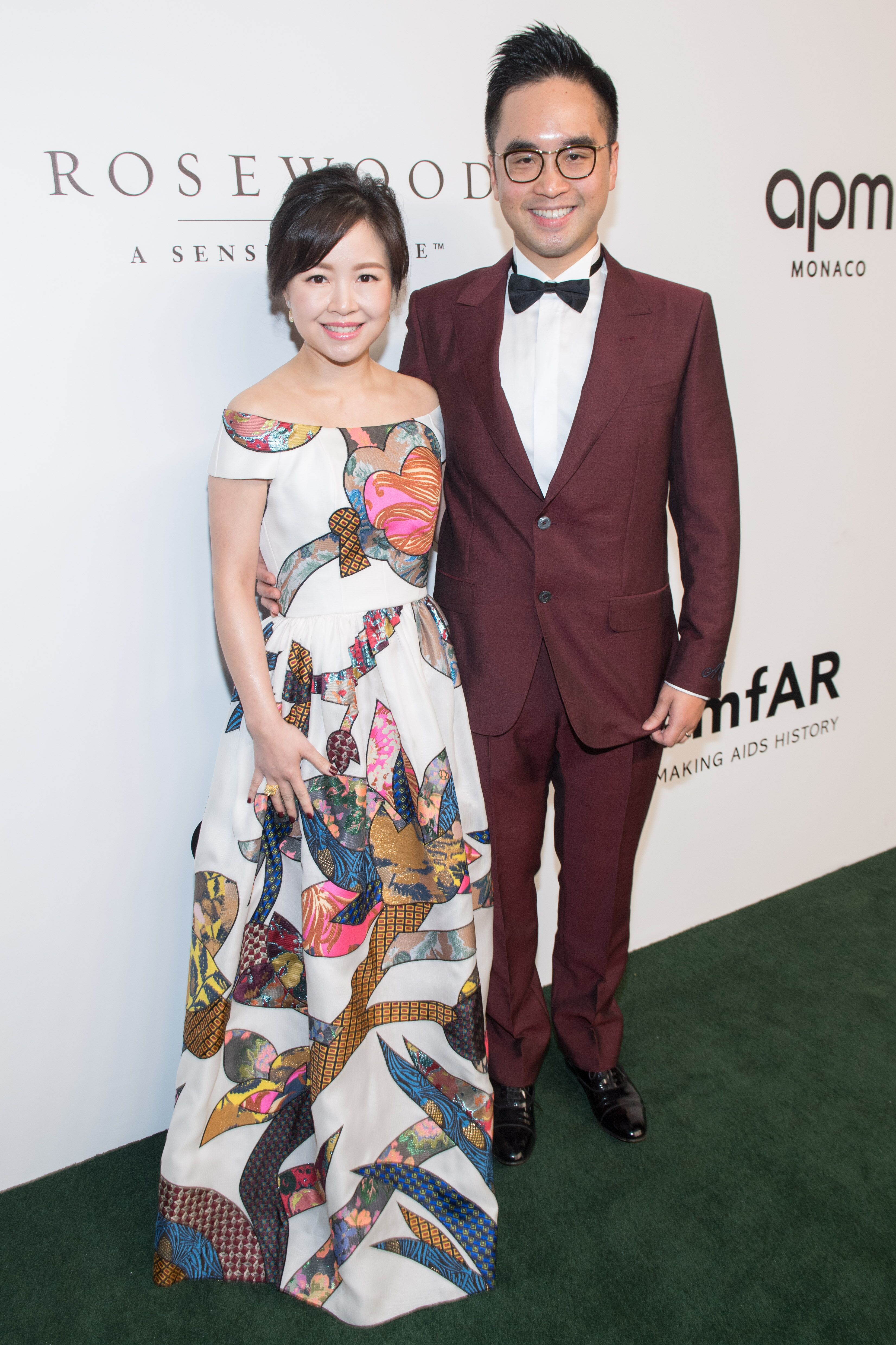 Adrian Cheng and wife, Jennifer Yu on the amfAR red carpet.