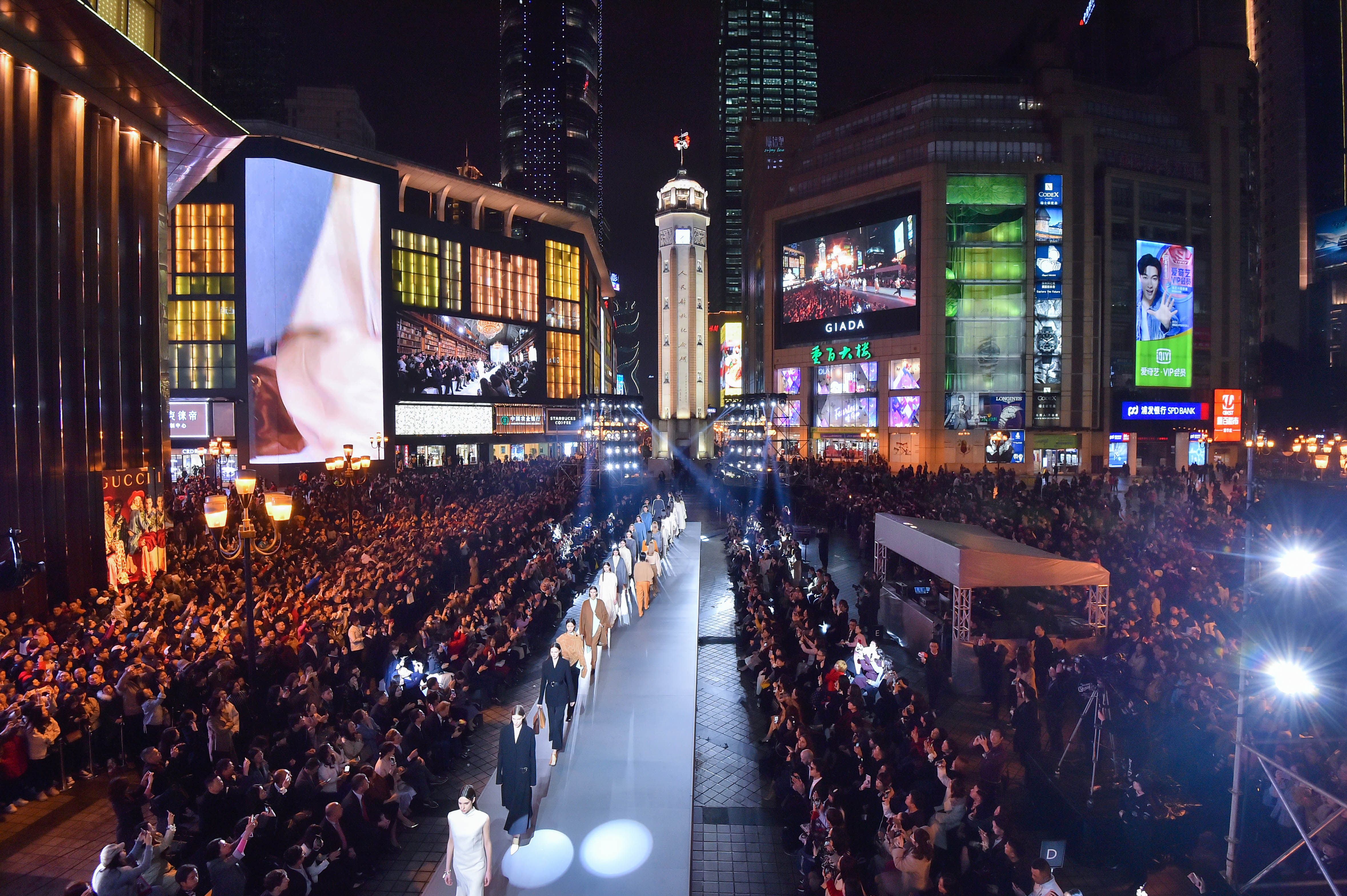 A large crowd gathered in the square to watch the show which was broadcasted on nearby large screens in addition to the 400 invited guests.