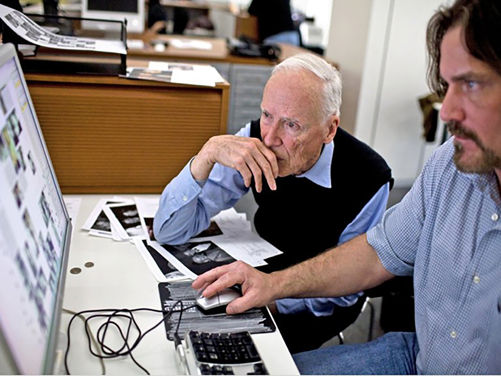 Bill Cunningham and John Kurdewan at work at The New York Times.