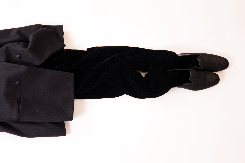 """A suit from the Giorgio Armani fall 2012 collection featured in the """"Romanzo Breve di Moda Maschile"""" exhibition."""