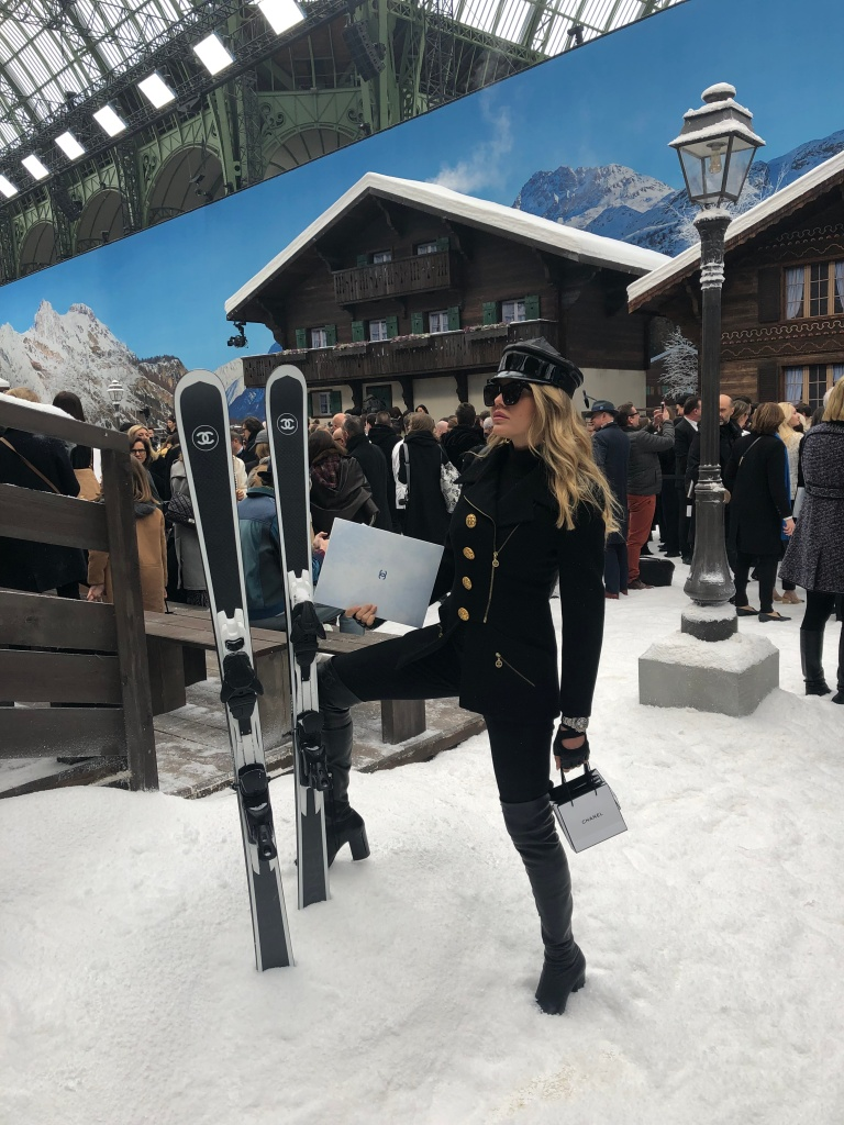A guest poses on the Chanel show set.
