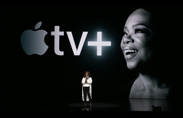 Oprah Winfrey announcing her new projects at Apple's press event.