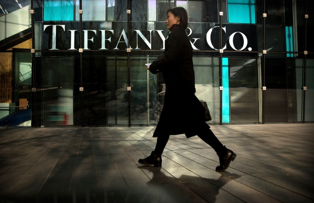 A woman walks past a Tiffany & Co. store at a shopping mall in Beijing. The designer boutiques of Manhattan and Paris are feeling the chill of a Chinese economic slowdown that has hammered automakers and other industries. That is jolting brands such as Louis Vuitton and Burberry that increasingly rely on Chinese customers who spend $90 billion a year on jewelry, clothes and other high-end goods. The industry already is facing pressure to keep up as China's big spenders shift to buying more at the spreading networks of luxury outlets in their own countryLuxury Shopping Chill, Beijing, China - 29 Nov 2018