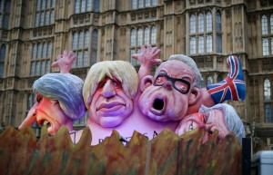 Effigies of British politicians from left, Prime Minister Theresa May, Boris Johnson and Michael Gove are driven on a truck by anti-Brexit, remain in the European Union supporters outside the Houses of Parliament in London, . British lawmakers faced another tumultuous day Thursday, as Parliament prepared to vote on whether to request a delay to the country's scheduled departure from the European Union and Prime Minister Theresa May struggled to shore up her shattered authorityBrexit, London, United Kingdom - 14 Mar 2019